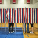 BEDFORD, NH - FEBRUARY 9: Voters head to the polling booths inside the Bedford High school, February 9, 2016 in Bedford, New Hampshire.  (Photos by Charles Ommanney/The Washington Post via Getty Images)