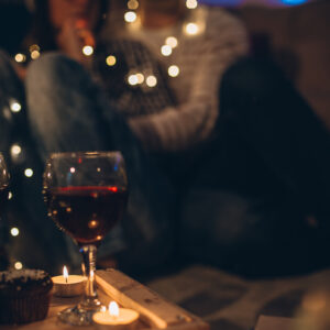 Young couple sitting on the floor enjoying the Christmas night